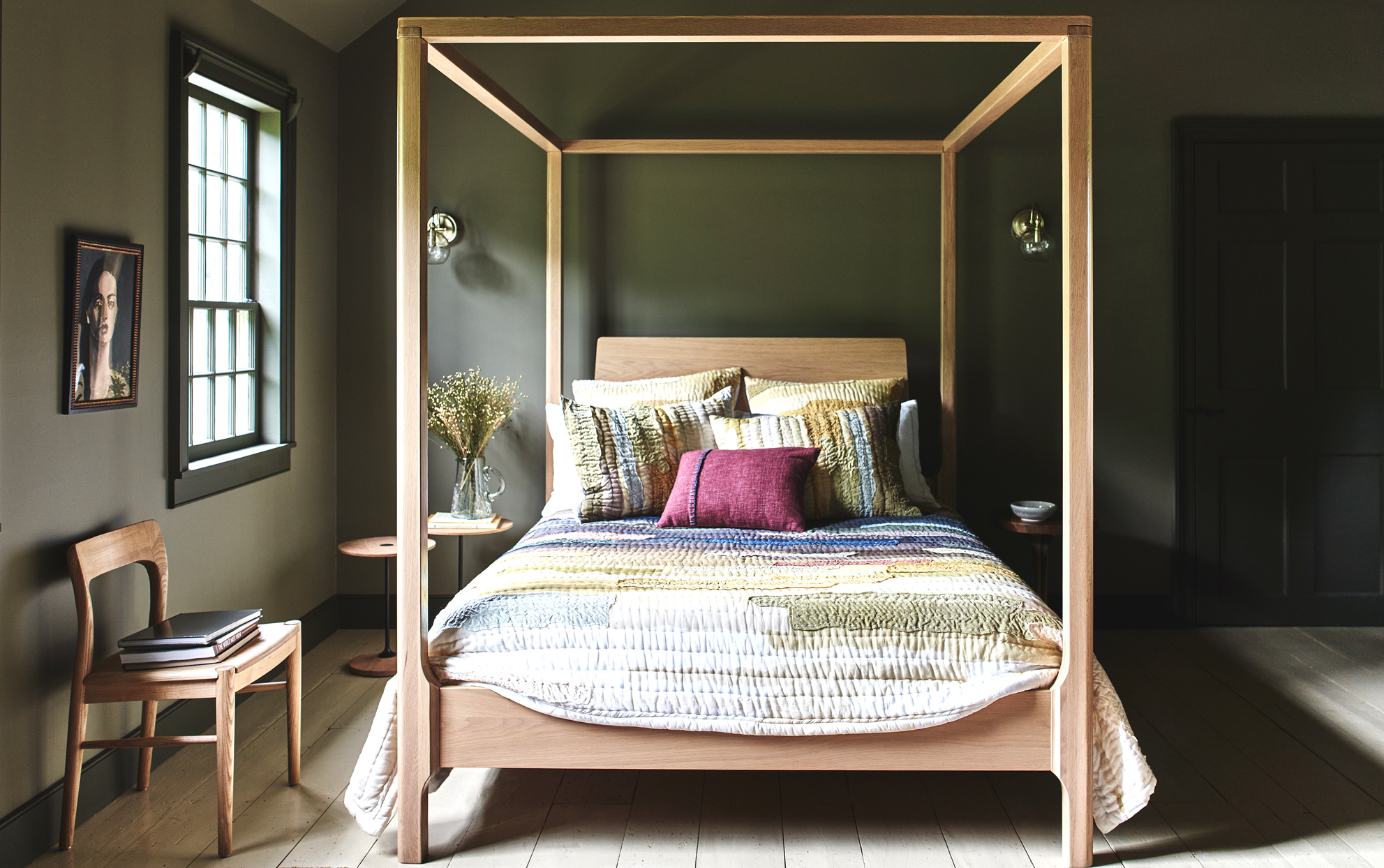 Anthropologie painted green bedroom with a four poster bed