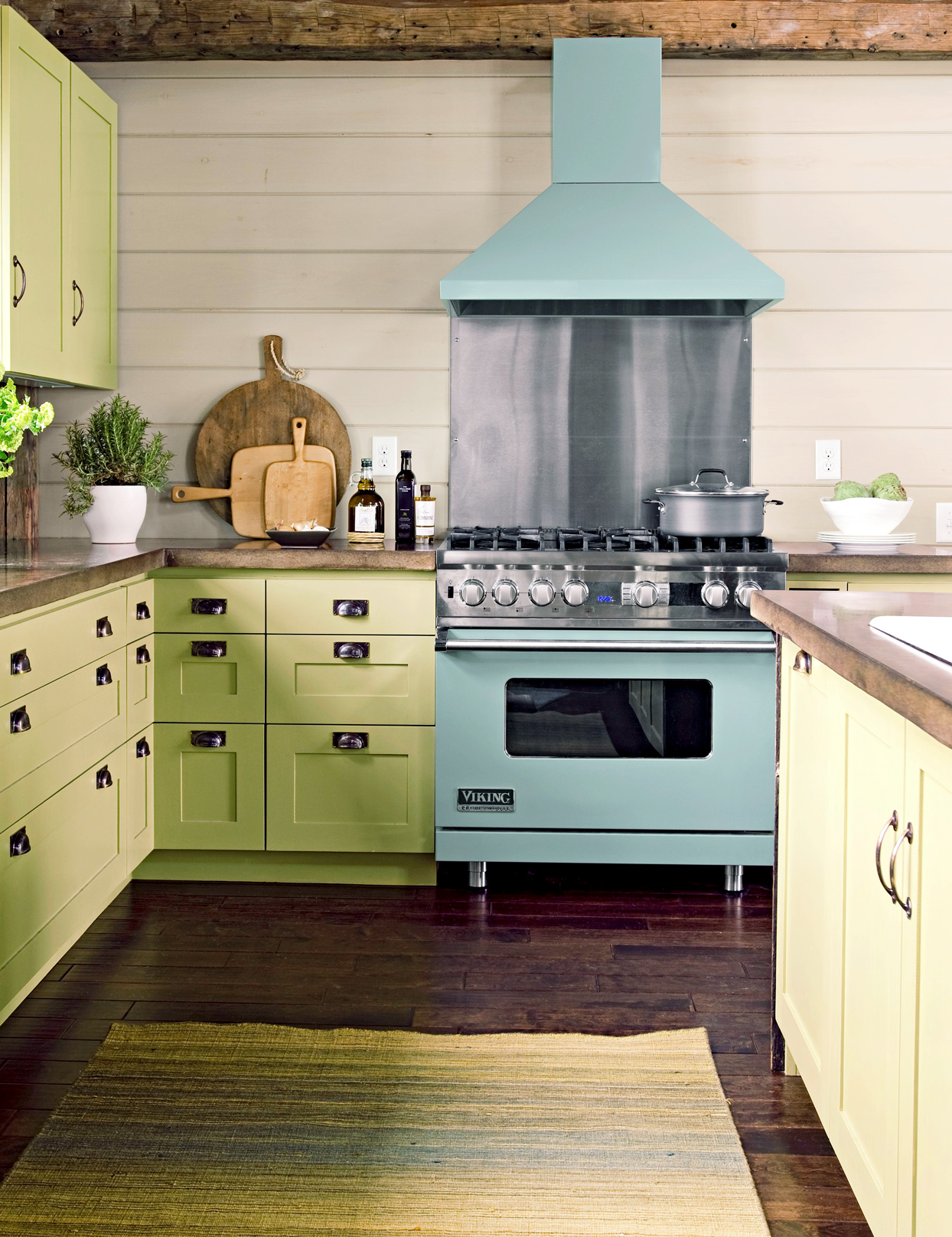 green kitchen with blue range and hood