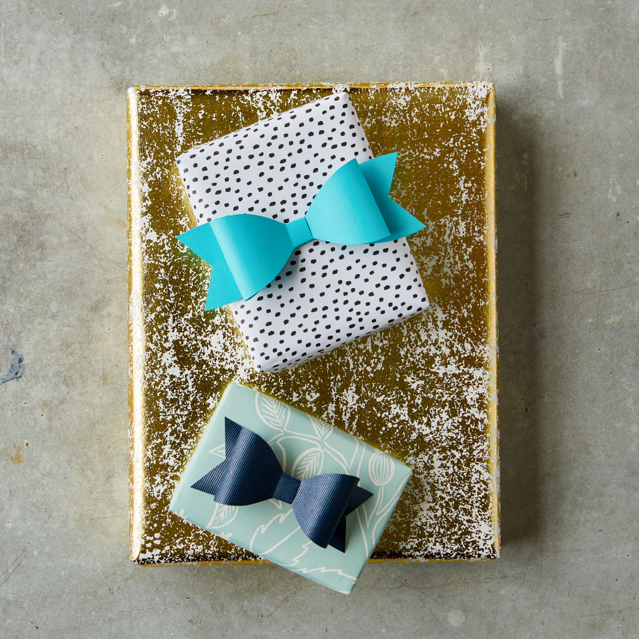 paper bows on top of presents