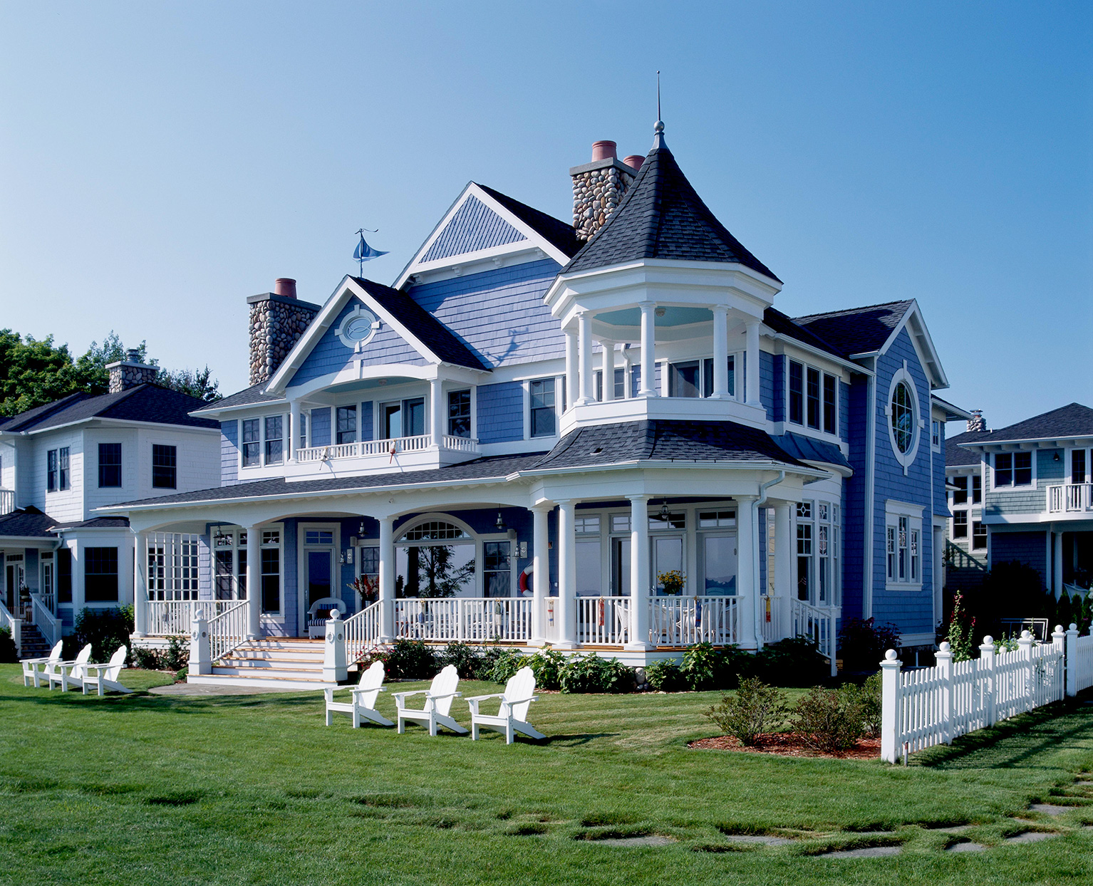 blue and white Victorian Lake Home with chairs