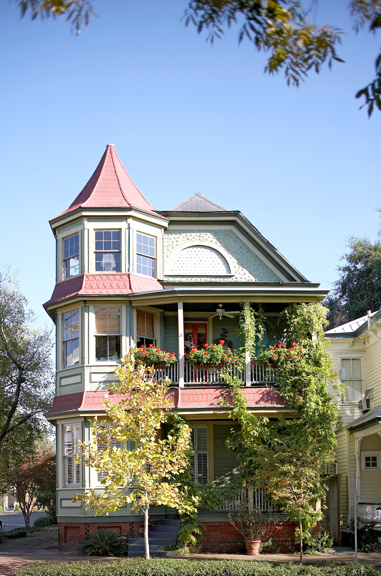 Victorian style home with vines