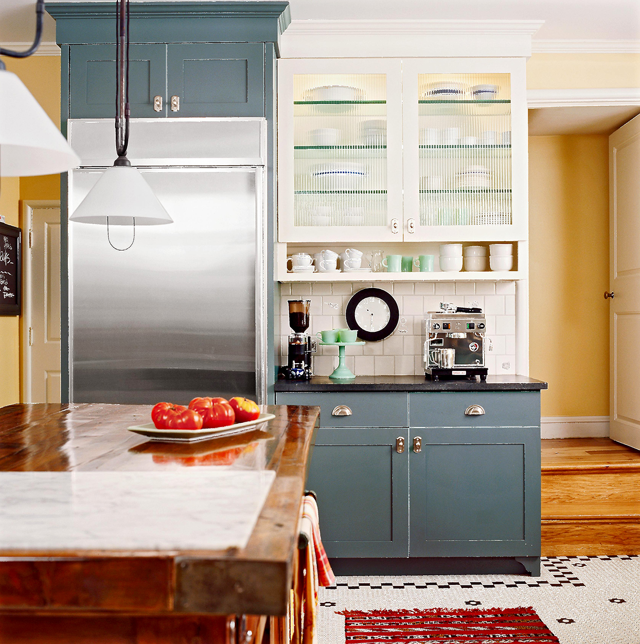 blue cabinets with coffee station shelf
