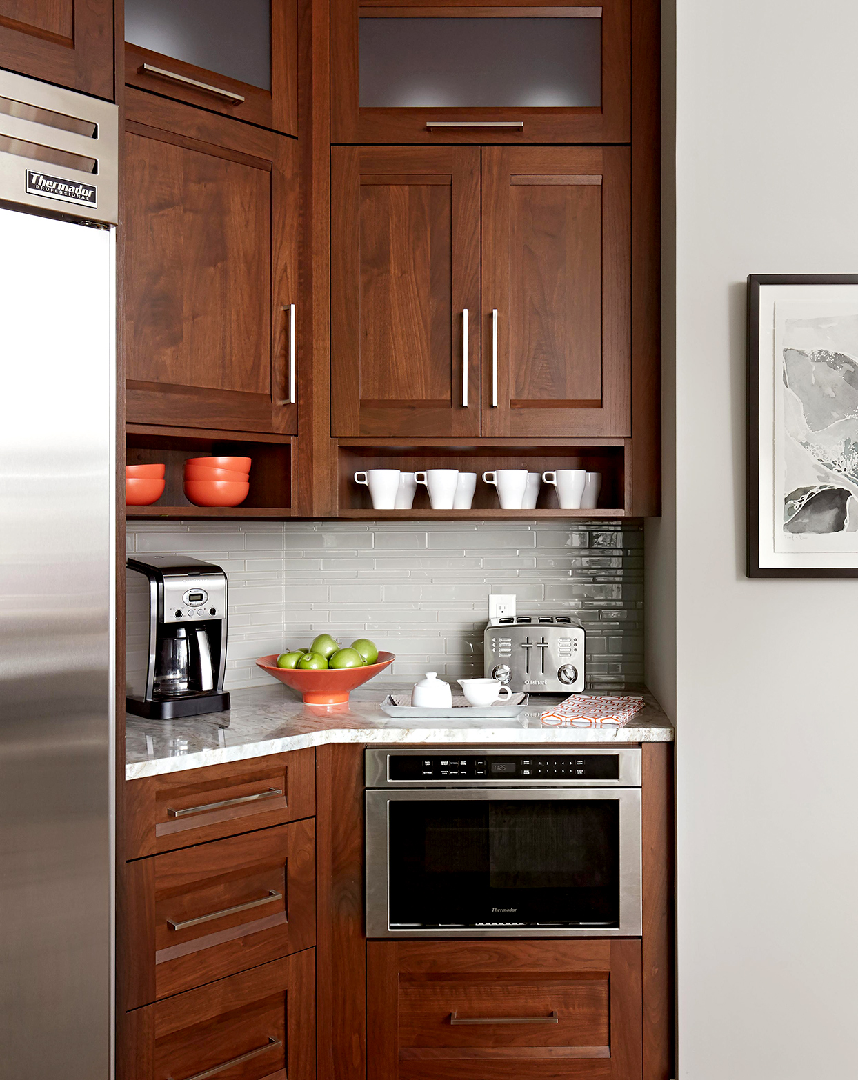Espresso wood cabinetry with white marble countertop