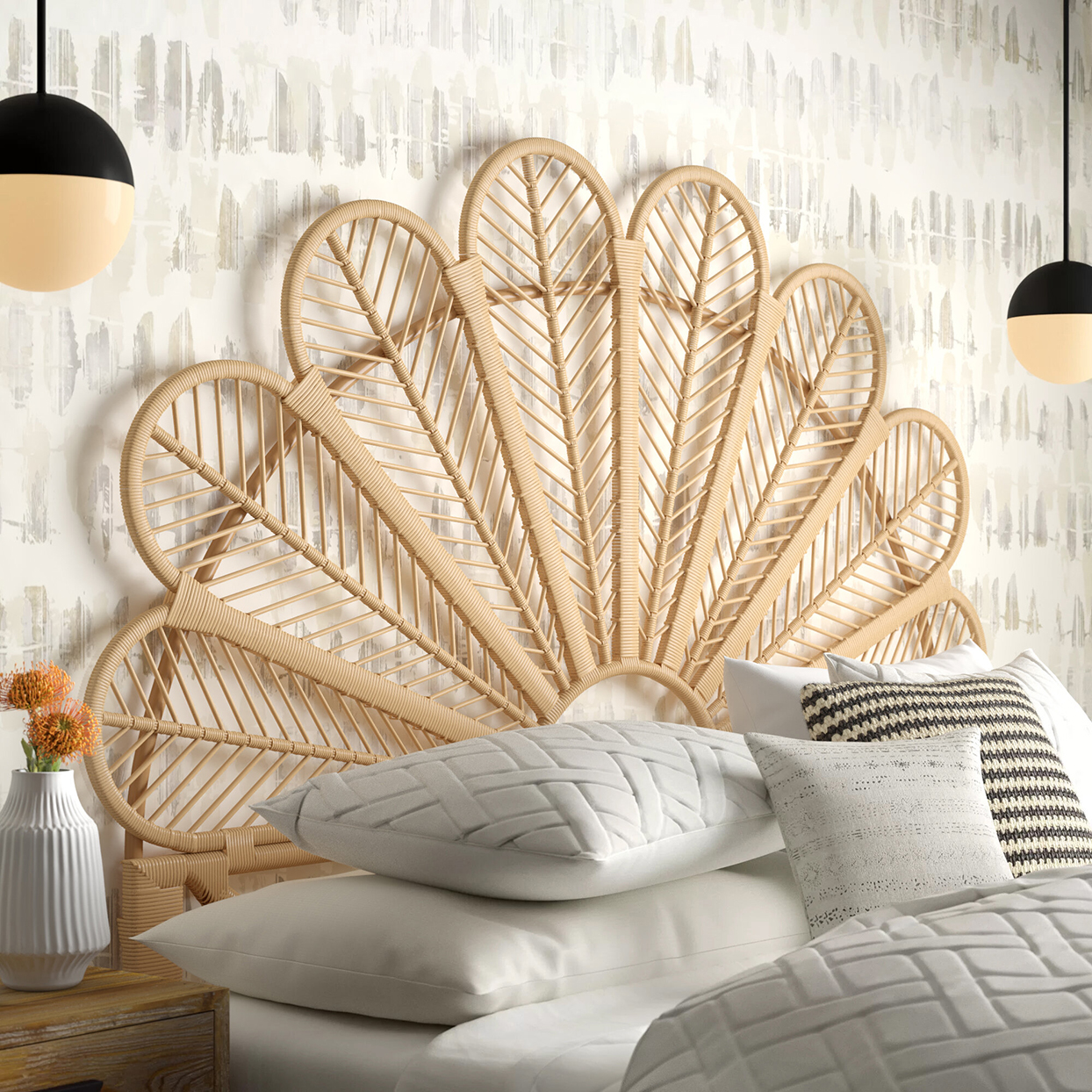 rattan headboard on white bed against wallpapered wall
