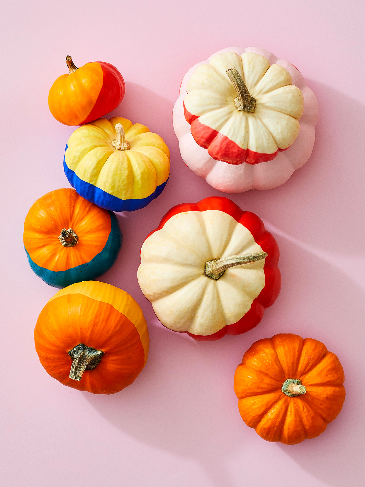 small colorblock pumpkins on pink background