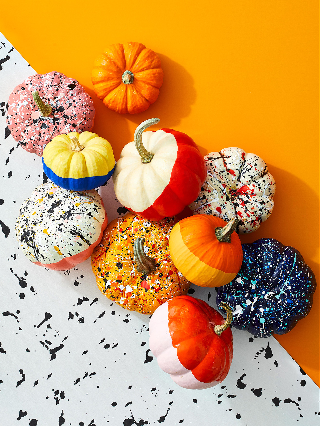 small pumpkins with painted colorblocking and splatter paint