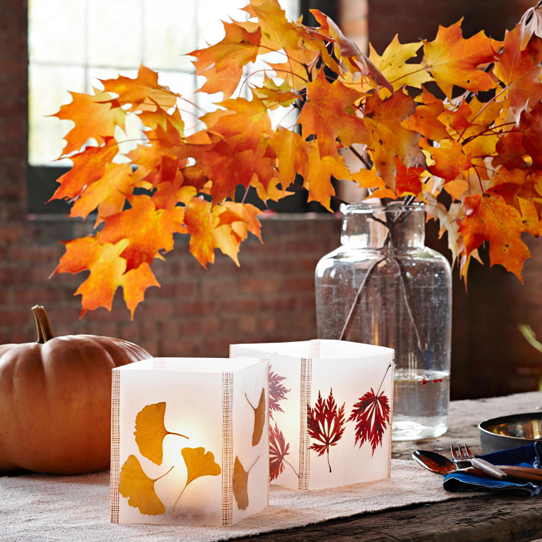 fall lanterns and leaves in vase