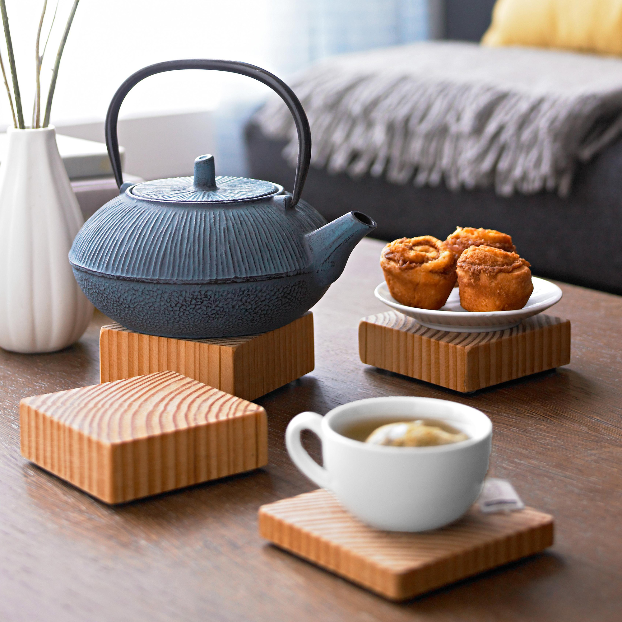 wooden coasters and blue teapot