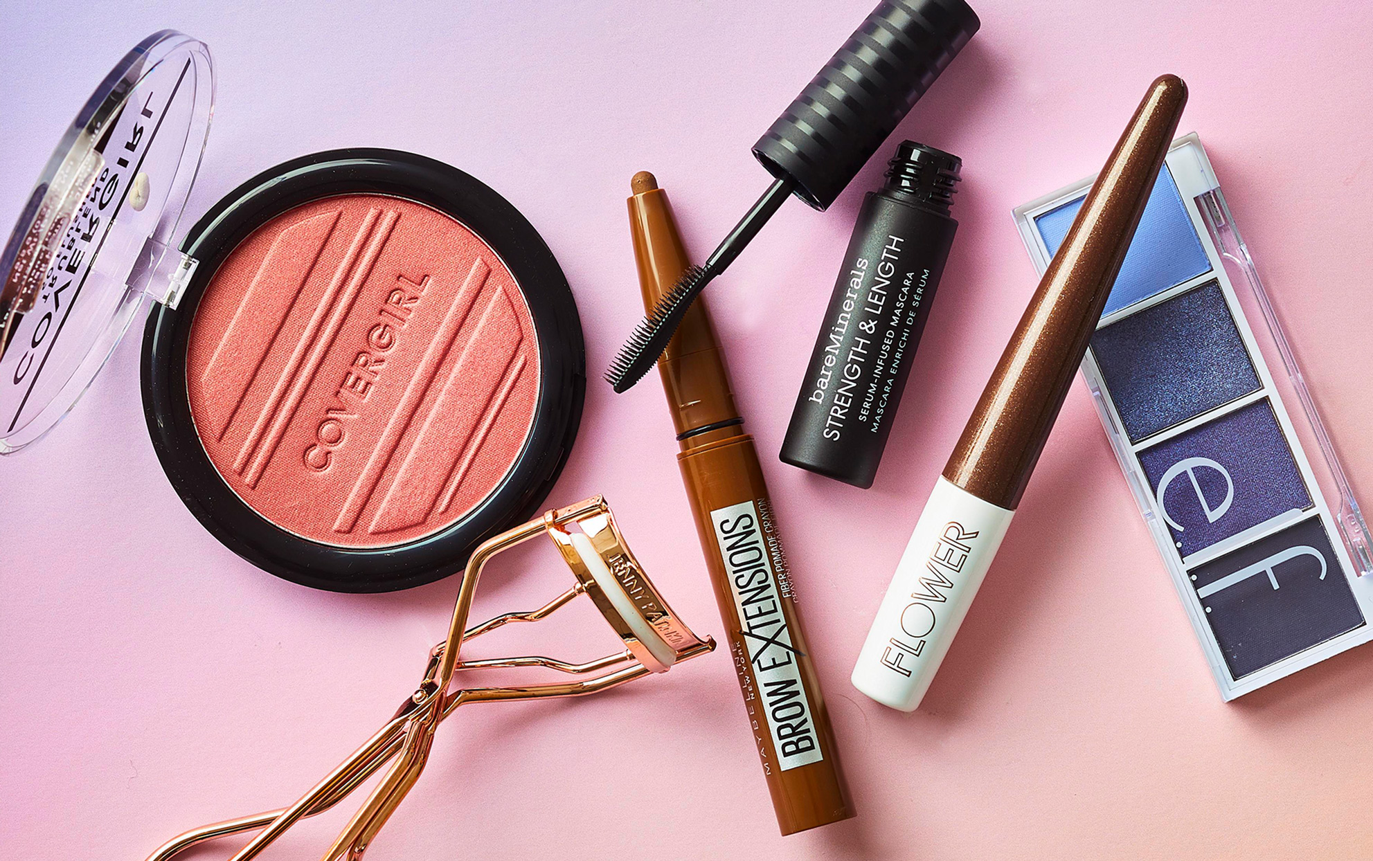 Several makeup beauty products on a pink background