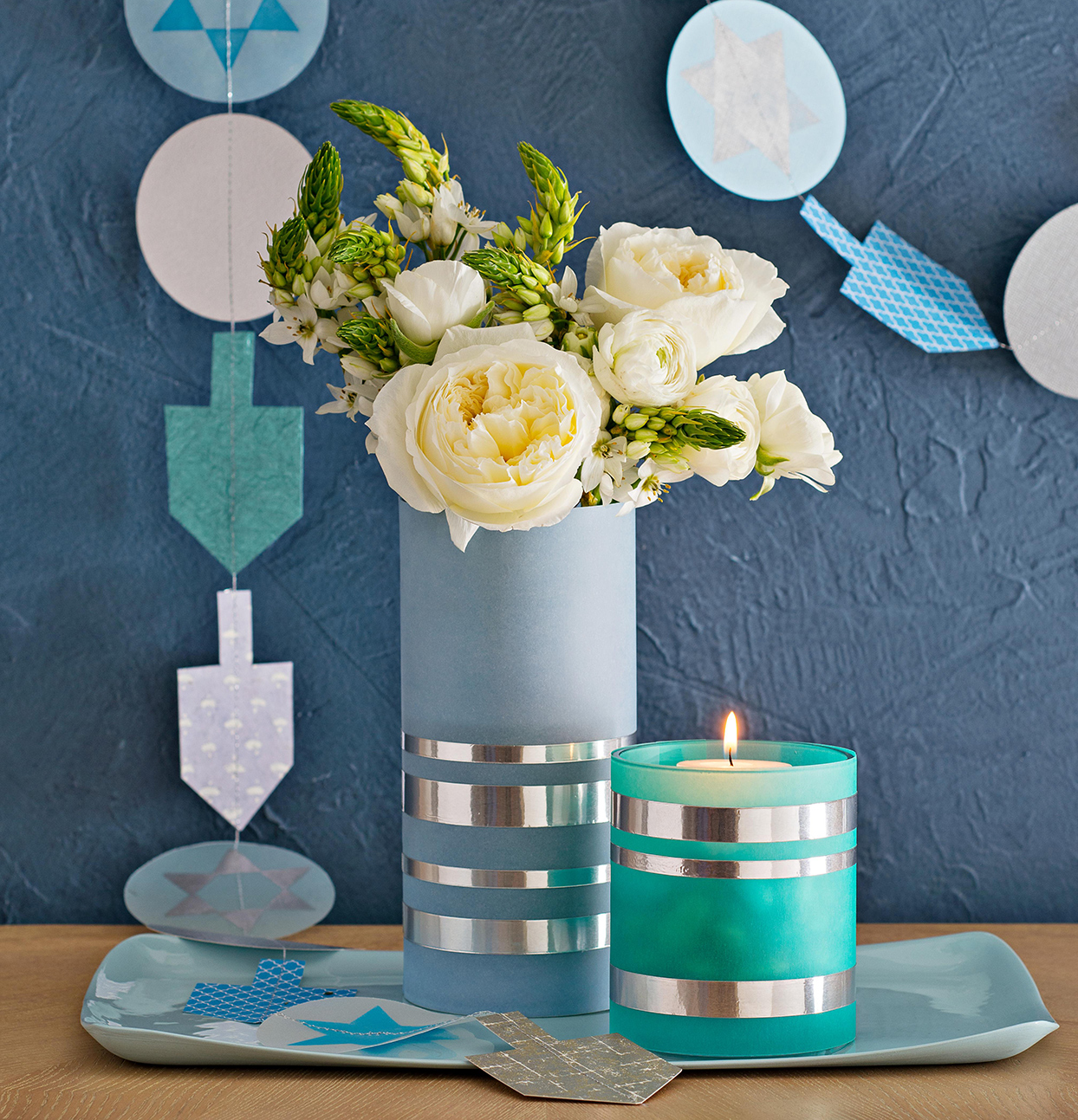 blue candle centerpiece with white flowers