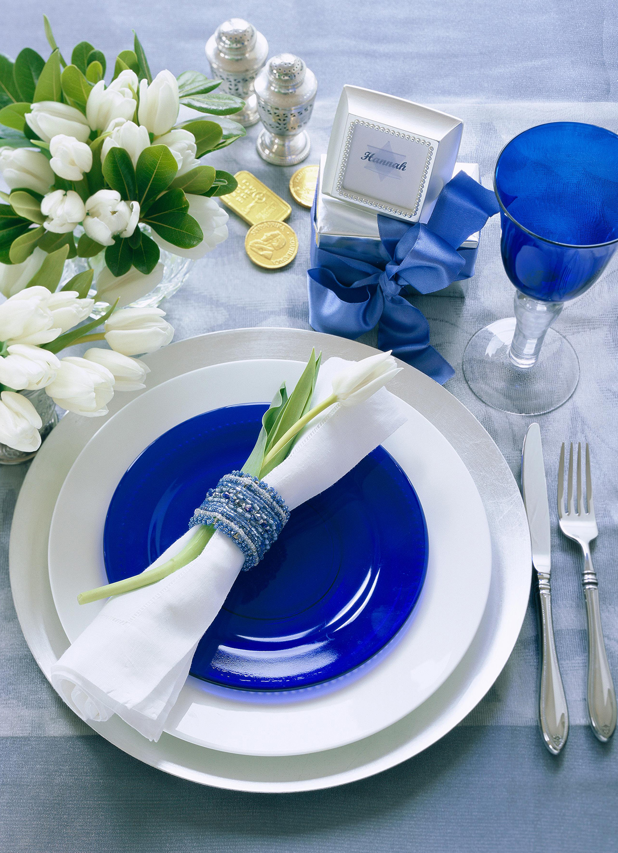 blue and white menorah-inspired place setting display