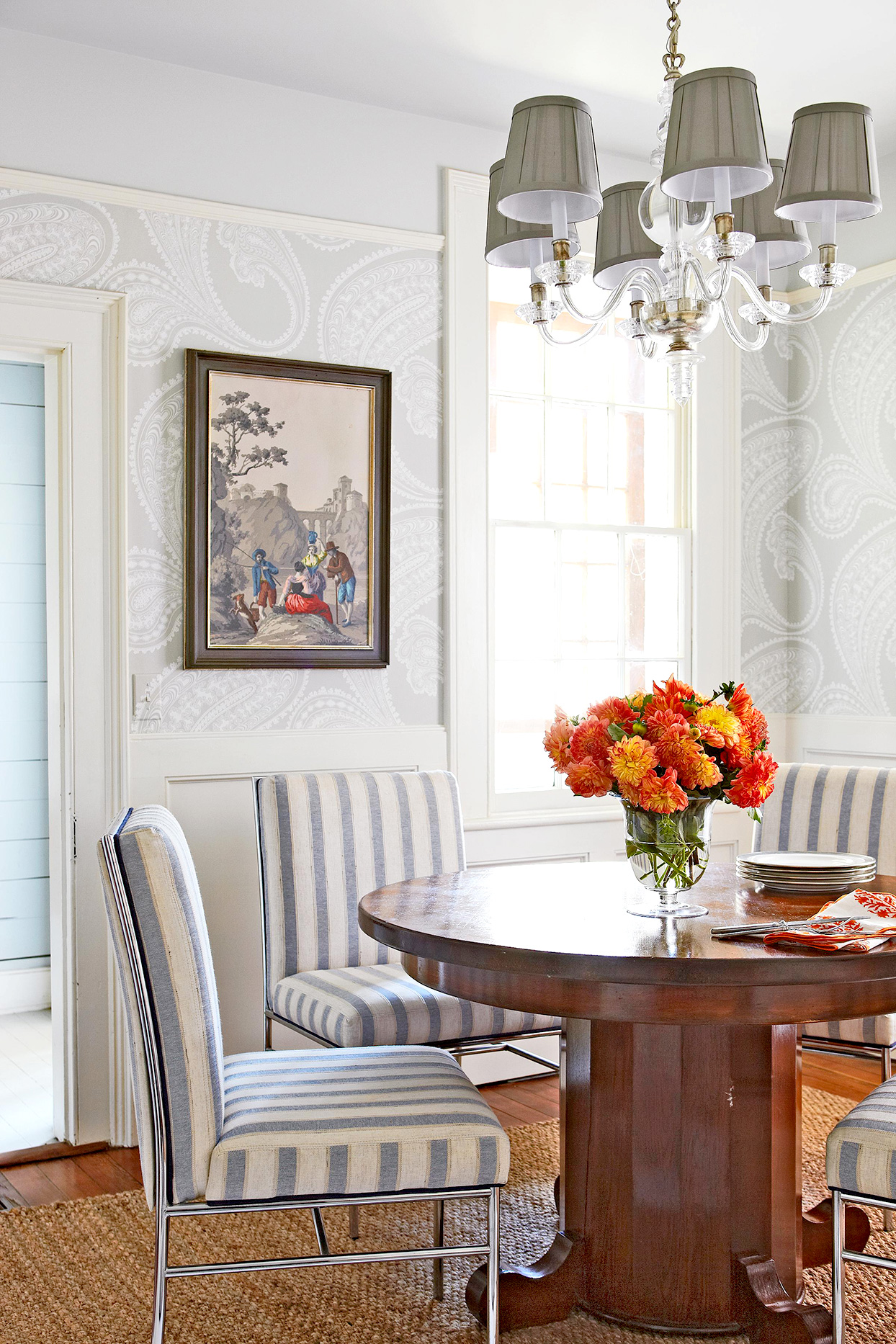 dining area with wooden table and blue and white striped chairs