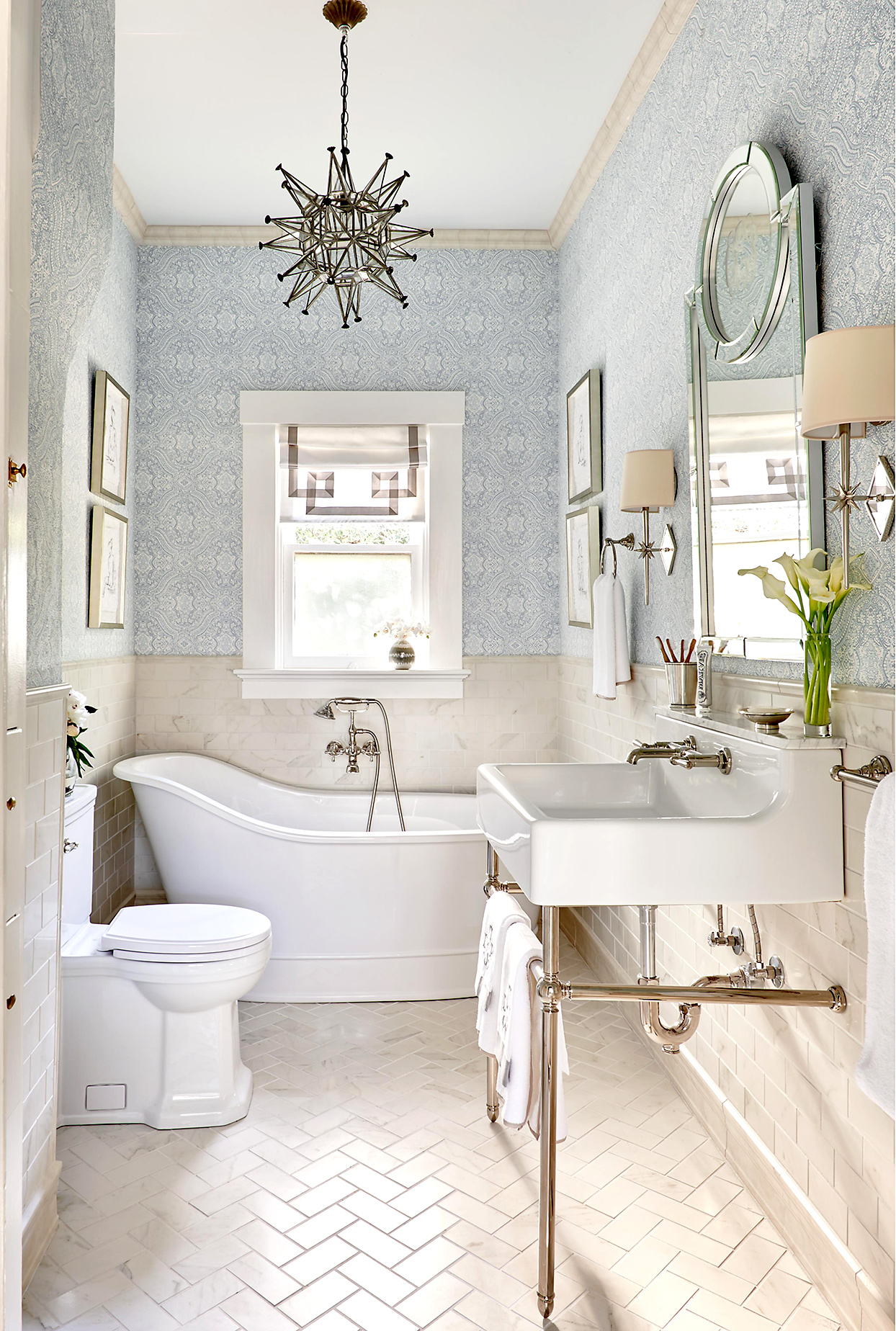 master bathroom with patterned wallpaper and white tile