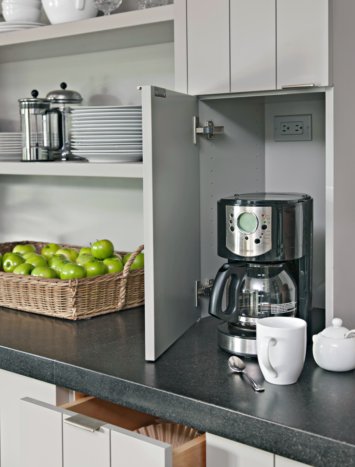 coffee maker pulled from cabinet