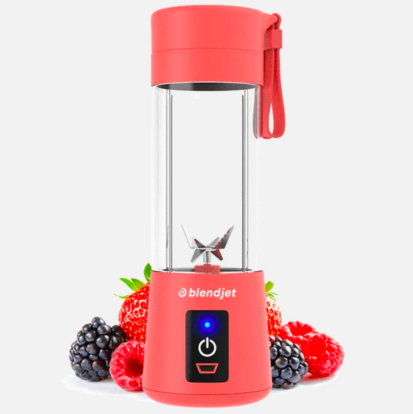 red miniature blender next to berries