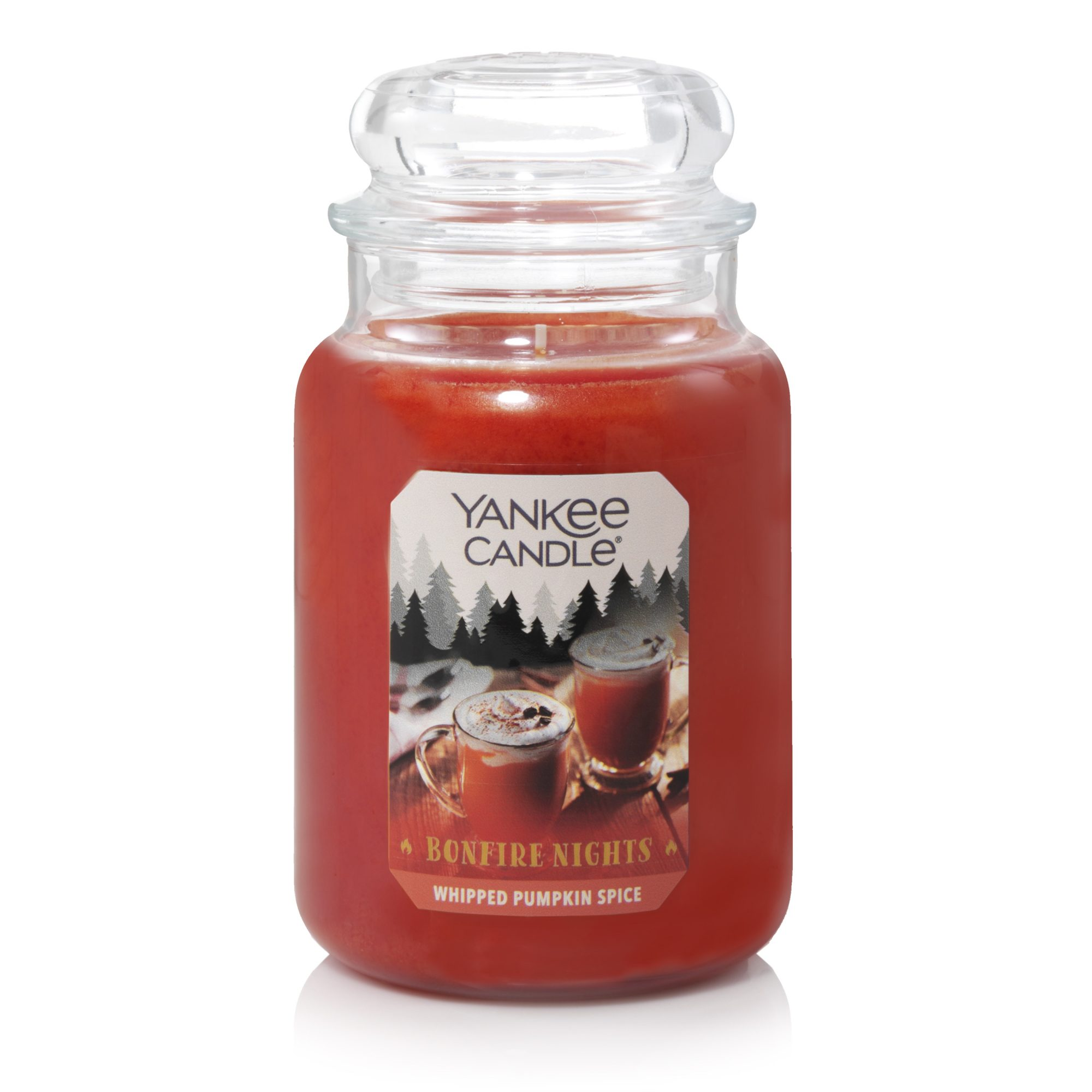 orange candle in glass jar