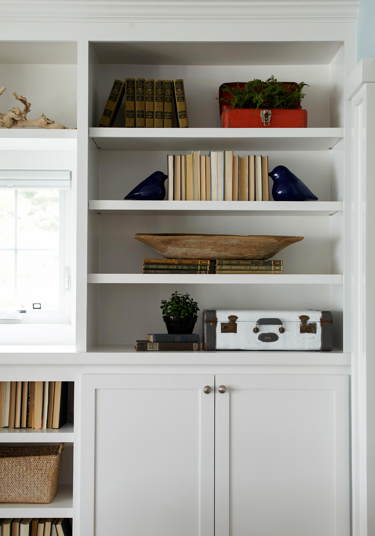 white bookshelf contrasting decor
