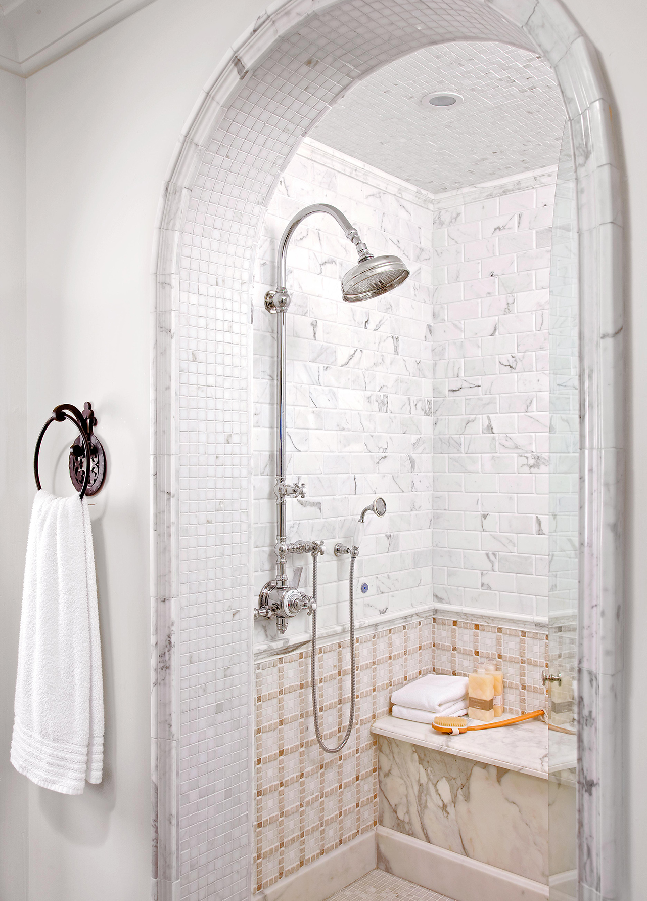 shower arched entry marble tile