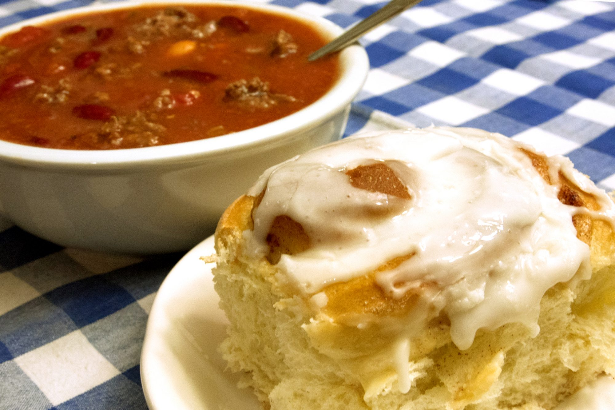 bowl of chili and cinnamon roll