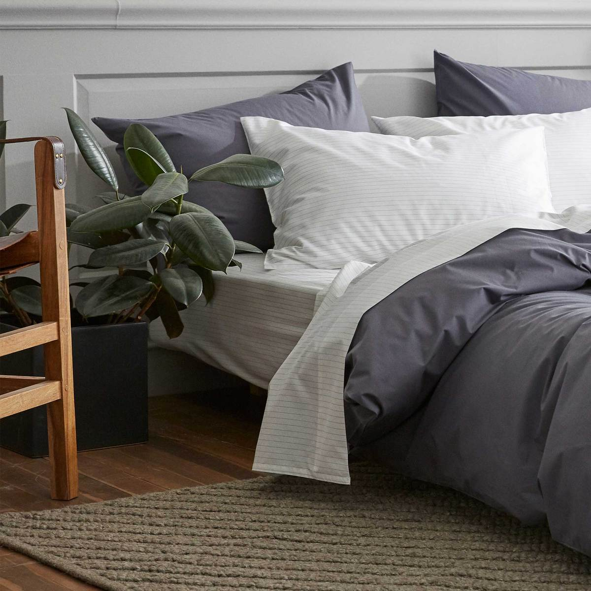 bed with white and gray sheets