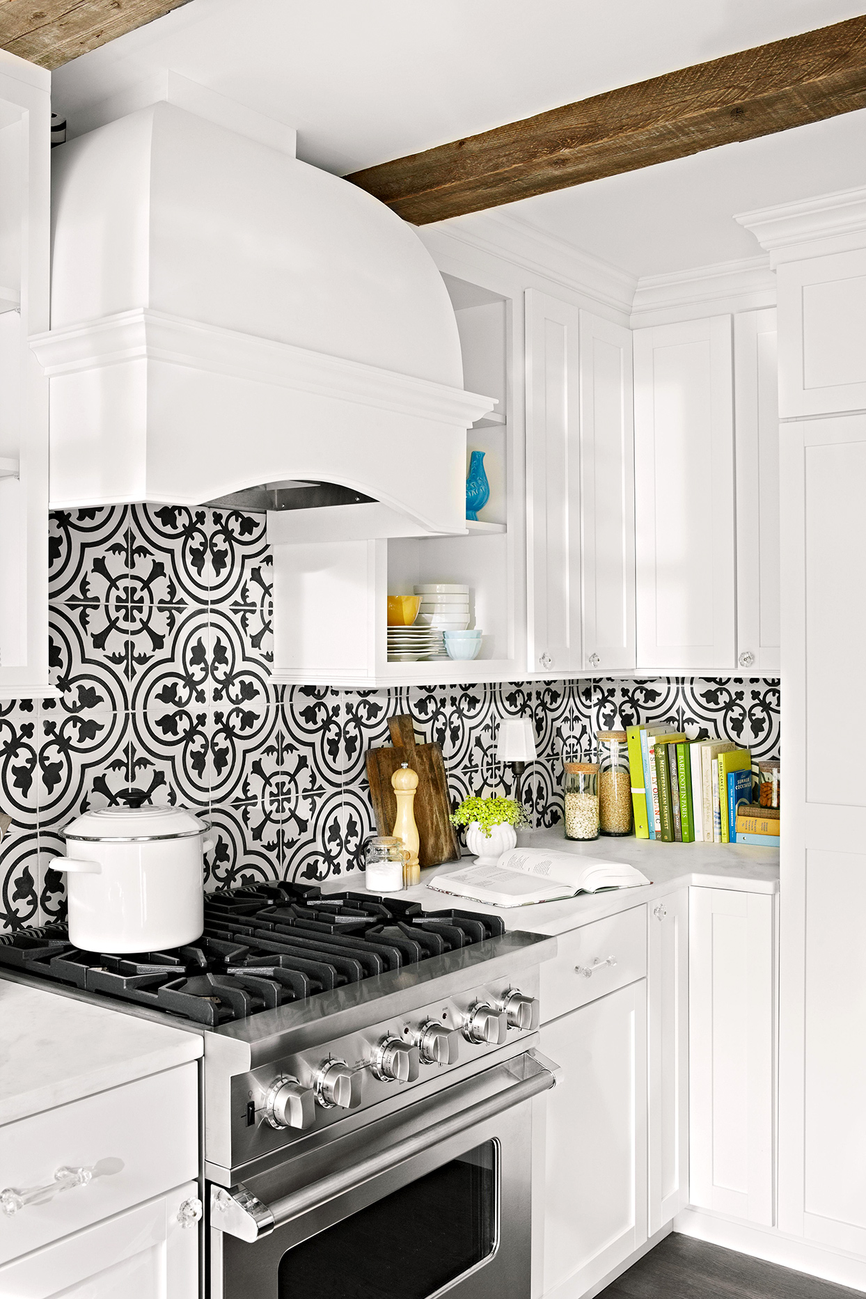kitchen with white cabinets and patterned backsplash