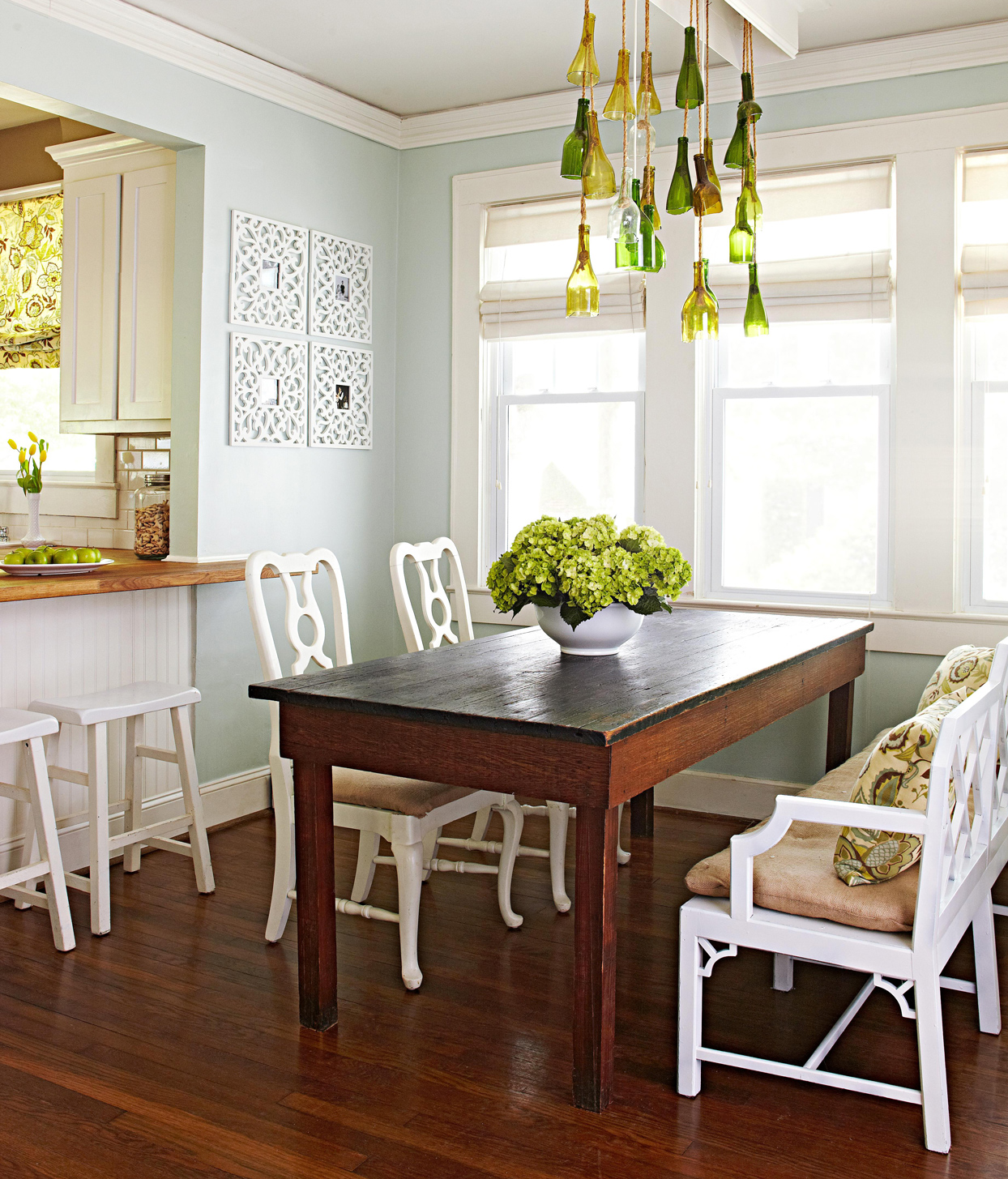 dining room with bottle chandelier