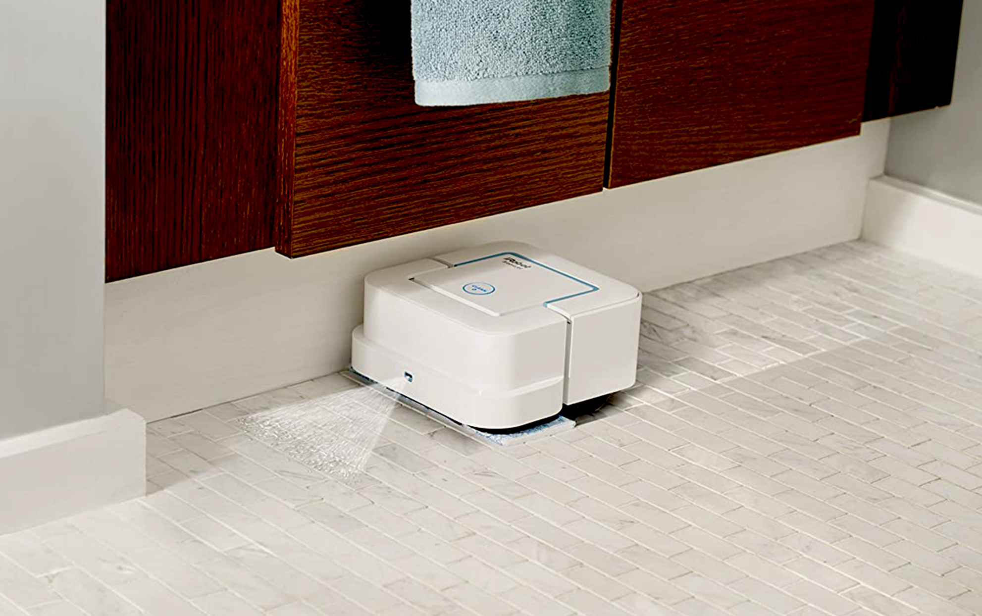 iRobot Mop being used on a bathroom tile floor
