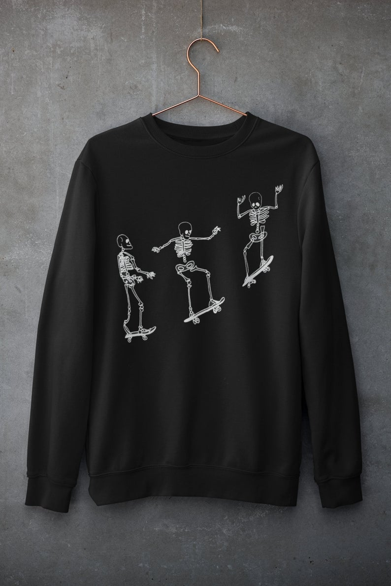 black sweatshirt with skeletons