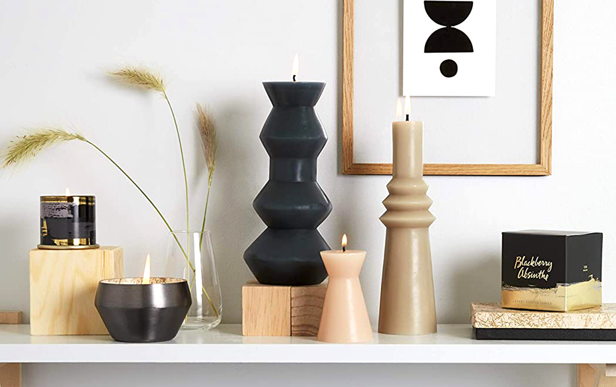 Structural candles on a shelf with other home decor