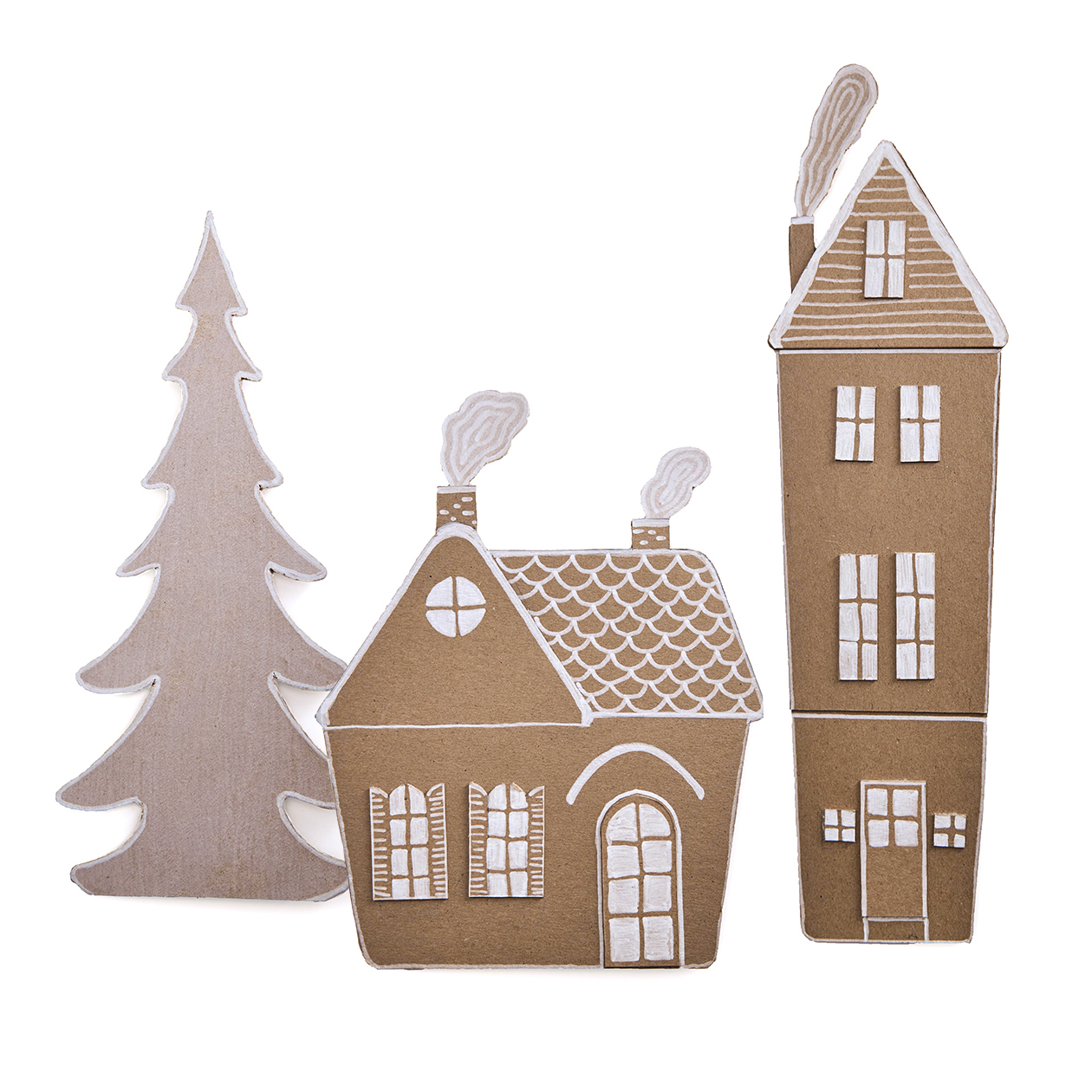 cut-out cardboard village houses on white