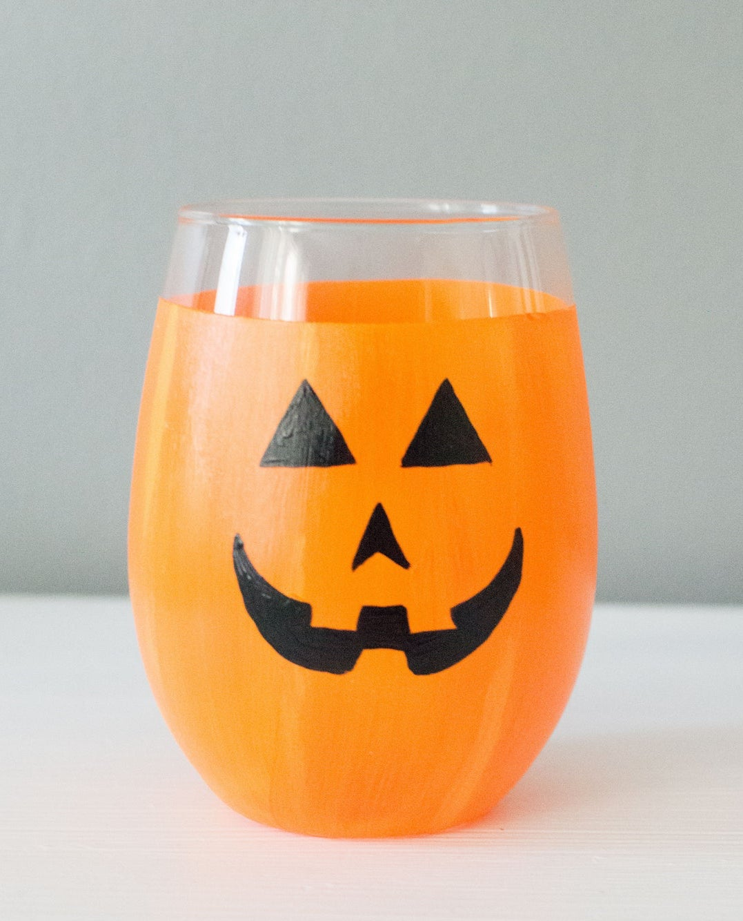 wine glass painted like a jack o lantern