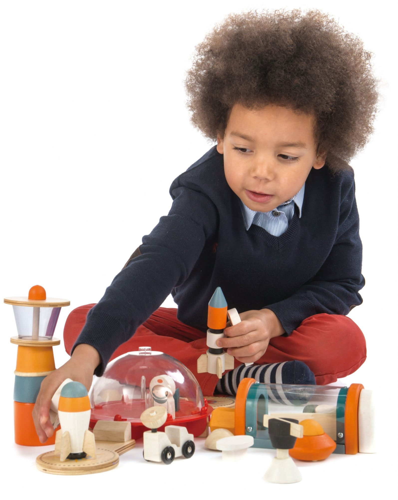 child playing with toy set