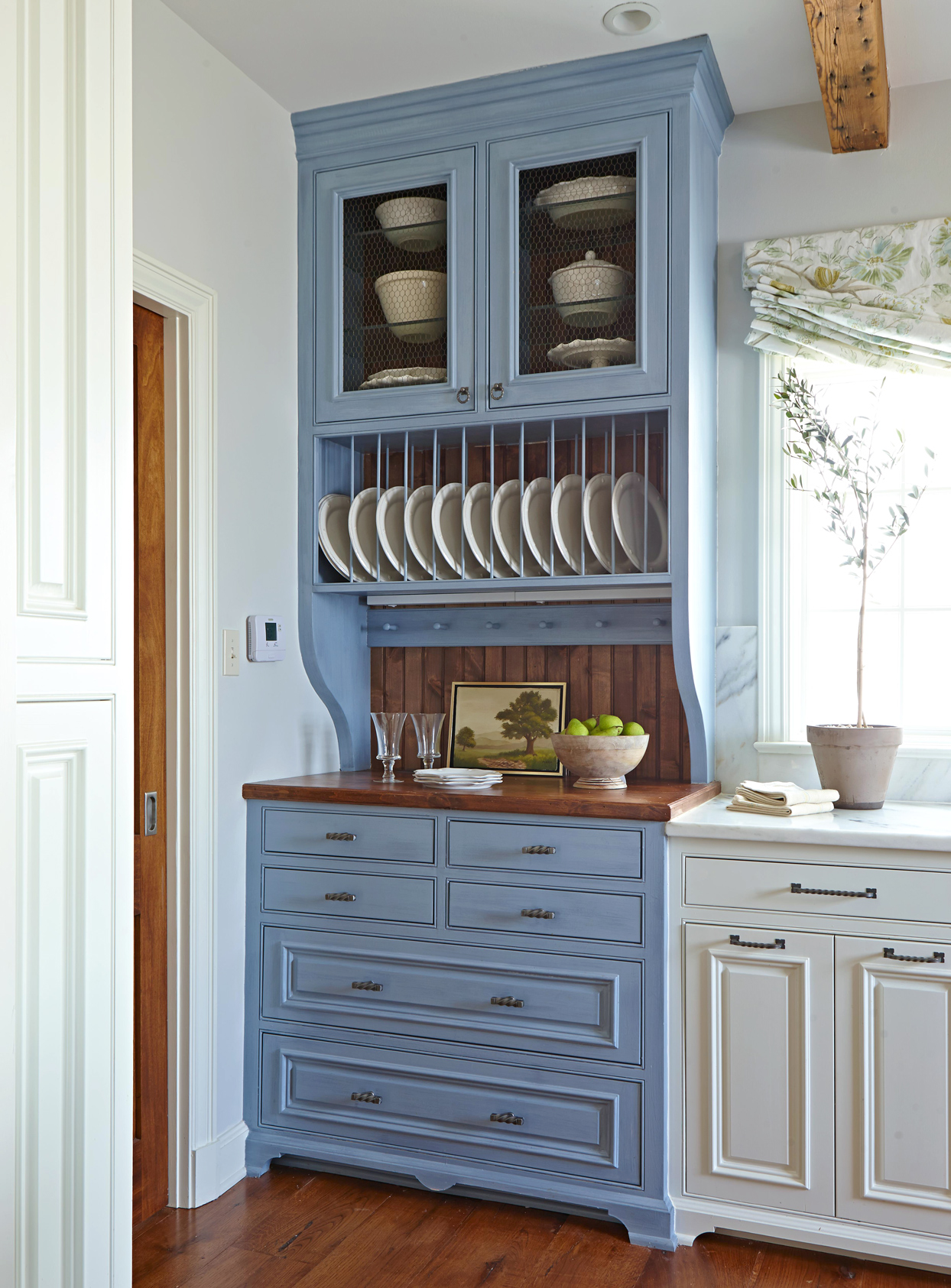 blue cabinet with dishes