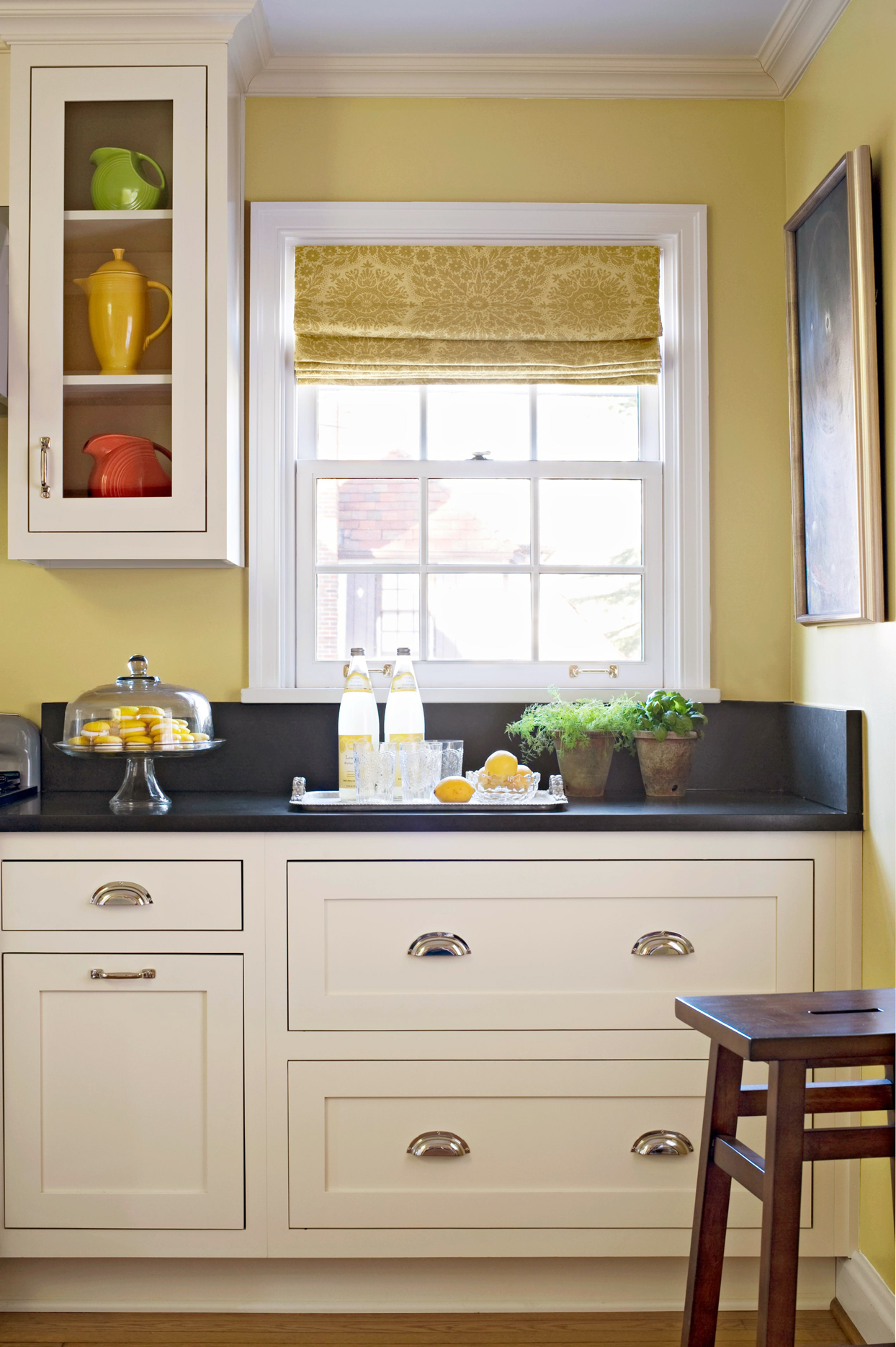 white cabinets with black stone countertops