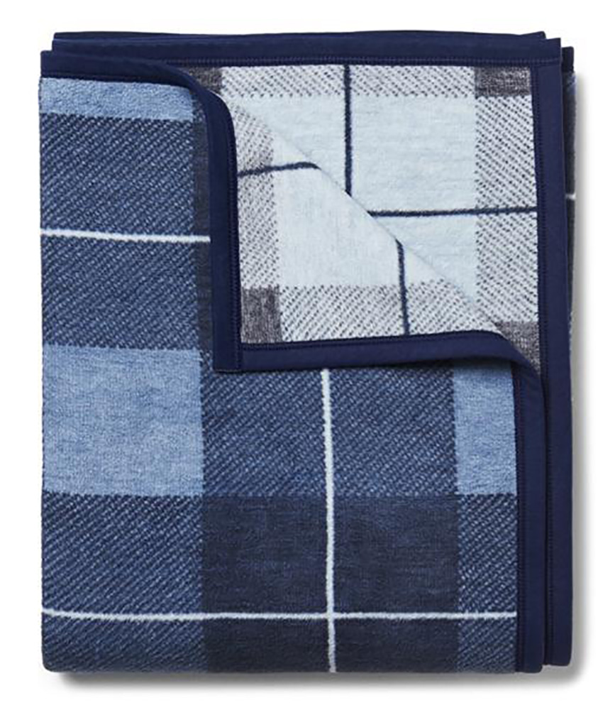 blue plaid folded outdoor blanket