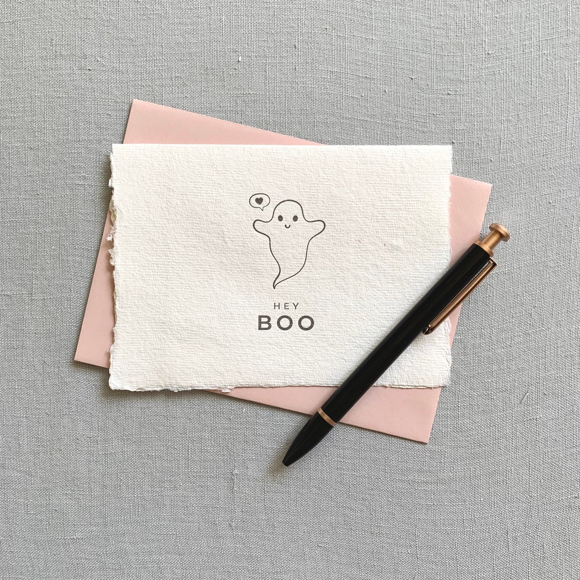 pink halloween card with a ghost on it