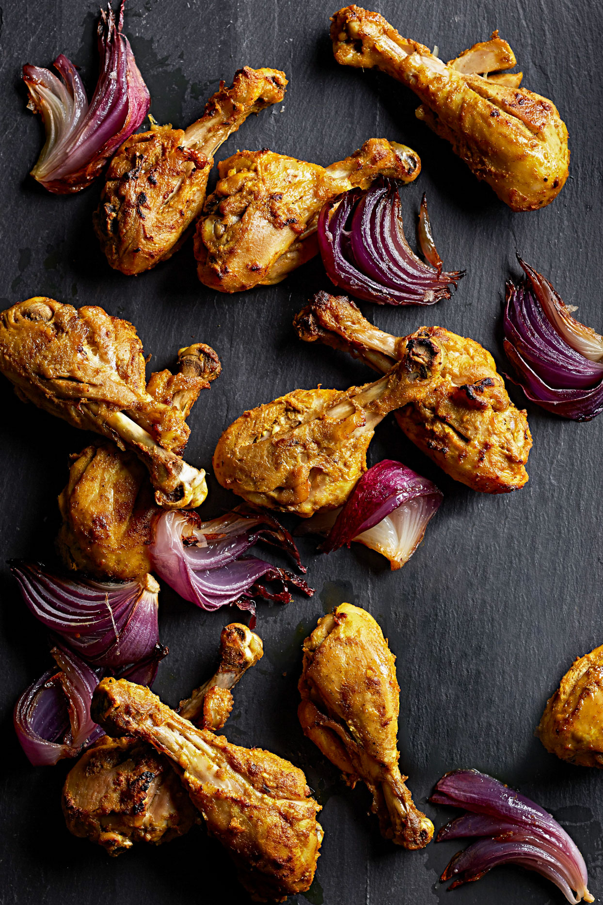 sheet pan of Tandoori Chicken Drumsticks and Roasted Red Onions