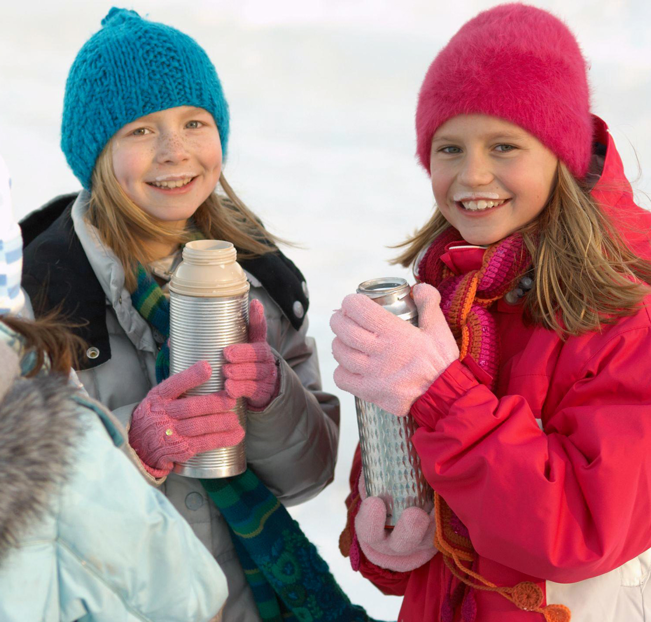 girls with thermoses of hot chocolate