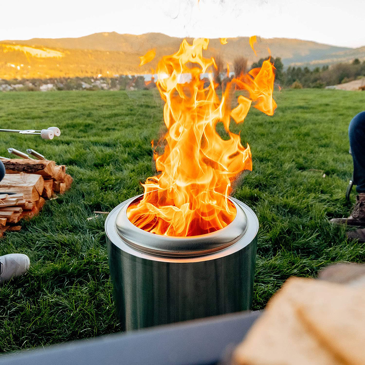 stainless-steel smokeless firepit on grass