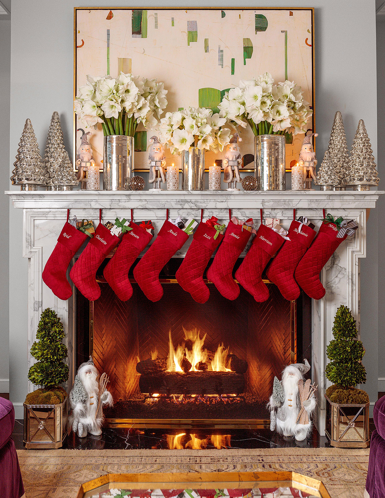 traditional Christmas mantel with hanging red stockings