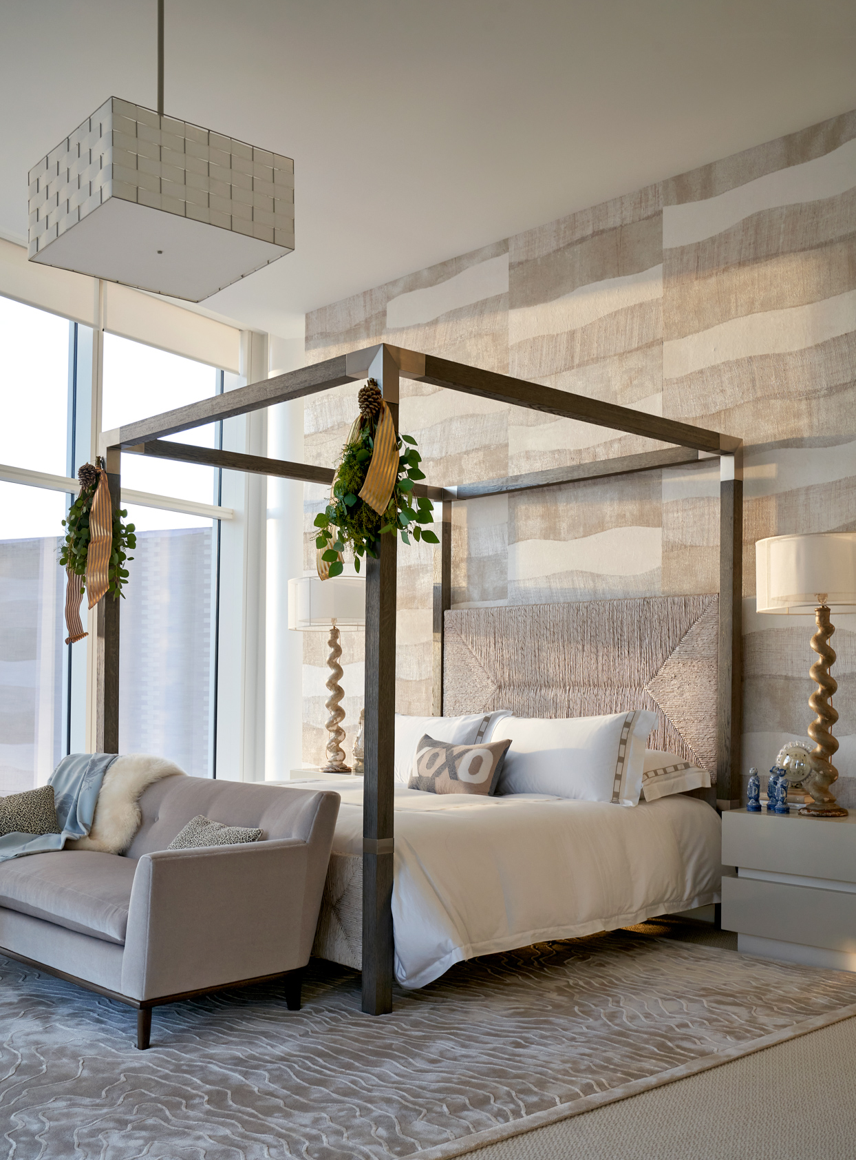 beige bedroom with accent wall and four poster bed