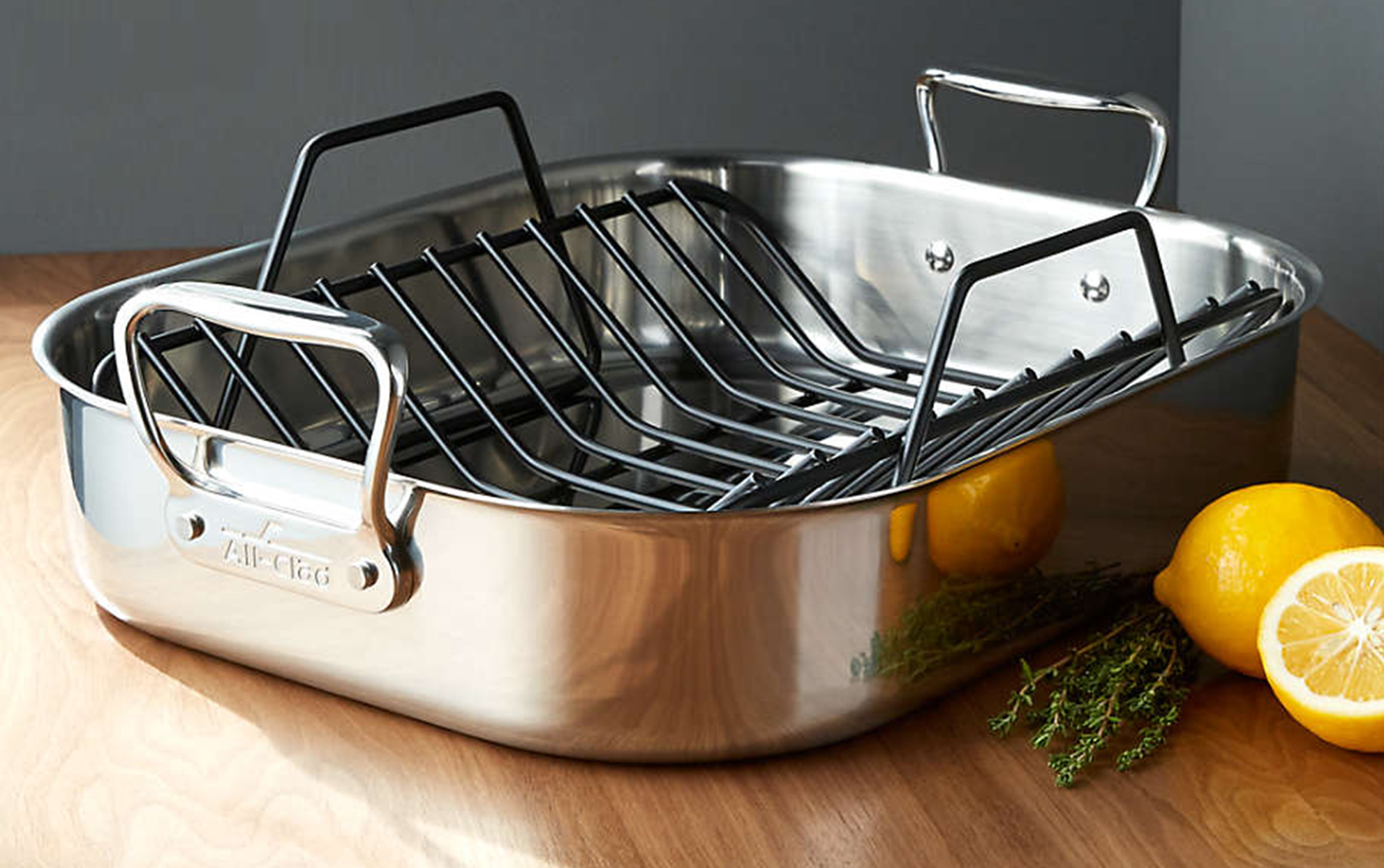 All-Clad Stainless Steel Large Roaster on a wooden surface