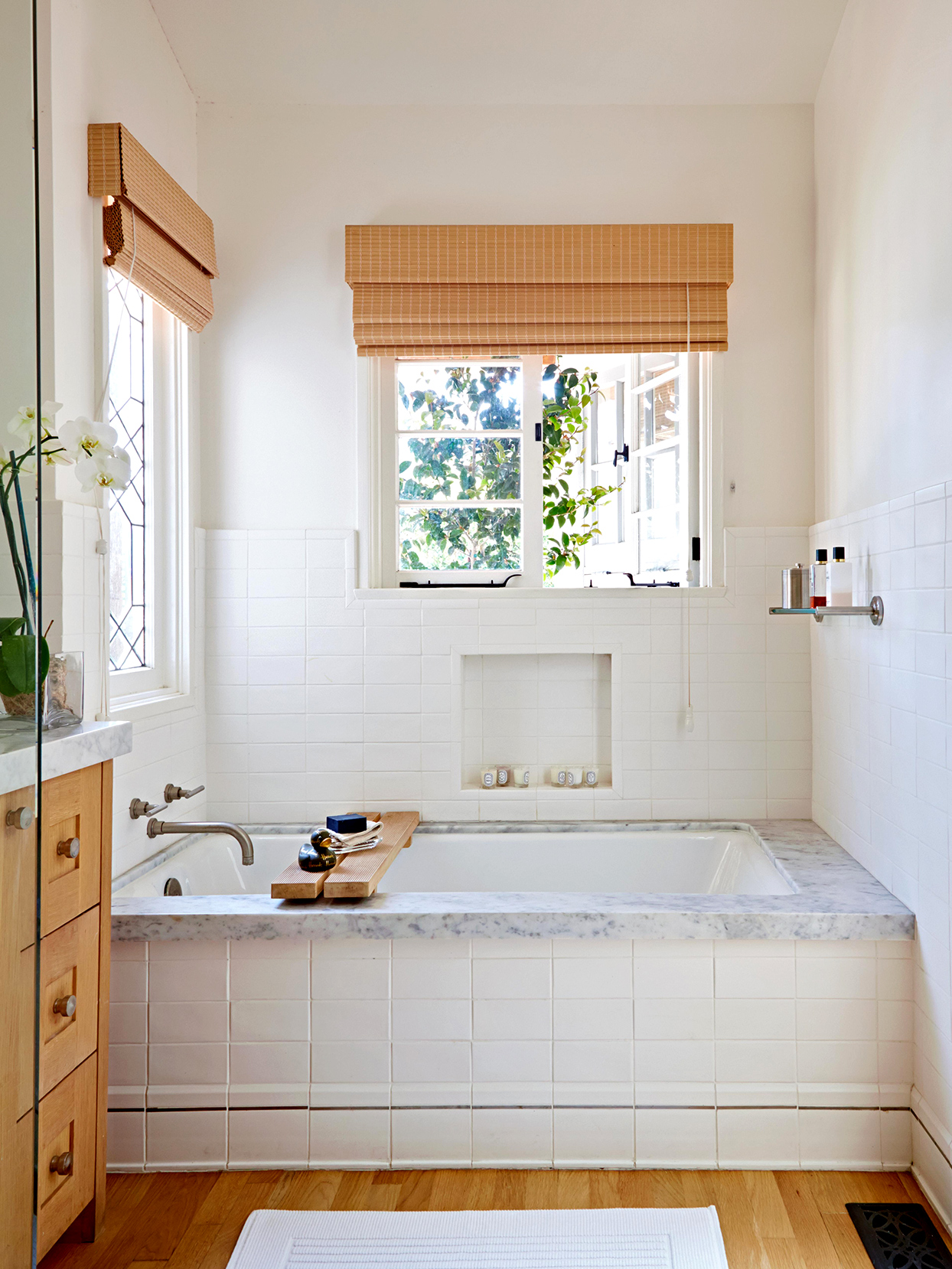 bathroom with wooden floors and windows