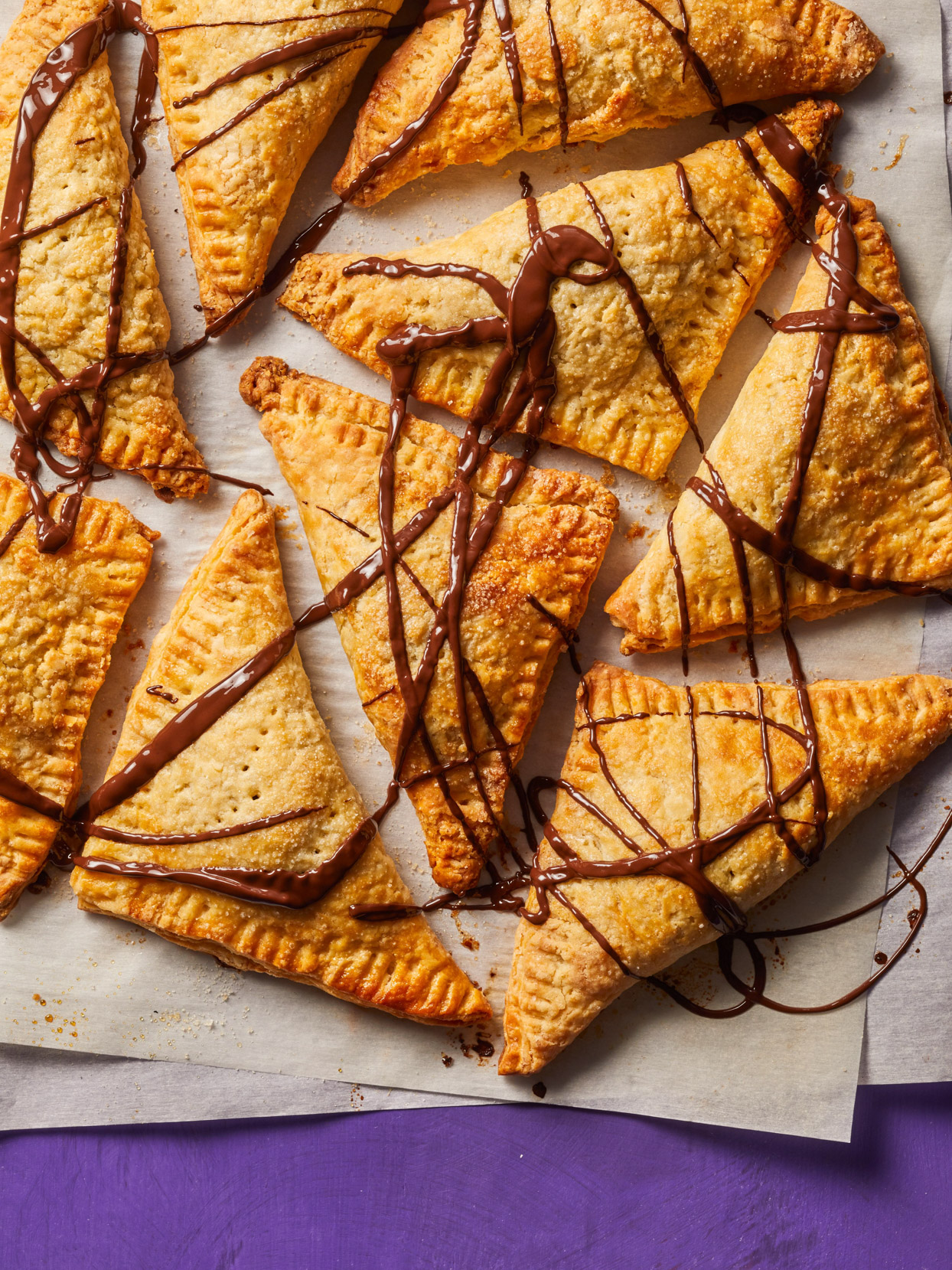 tray of Roasted Pumpkin Hand Pies with chocolate drizzle