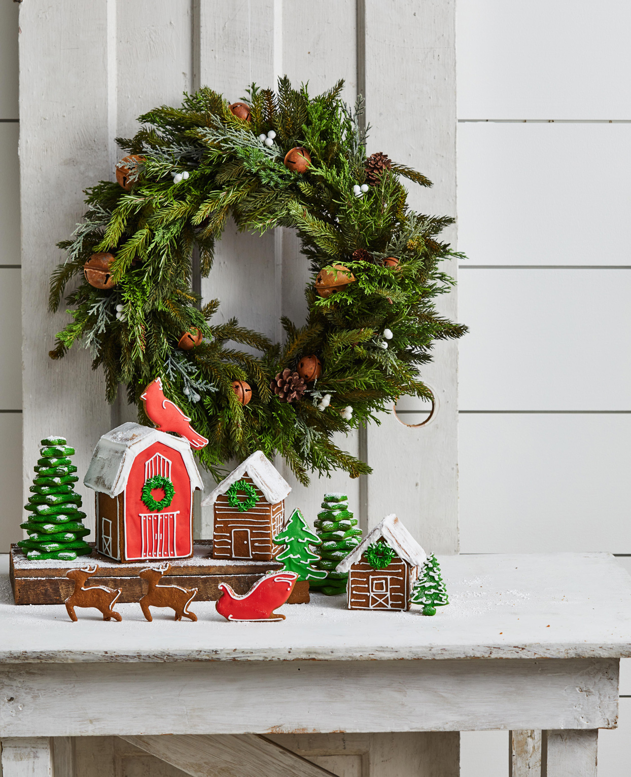 wreath behind christmas decorations