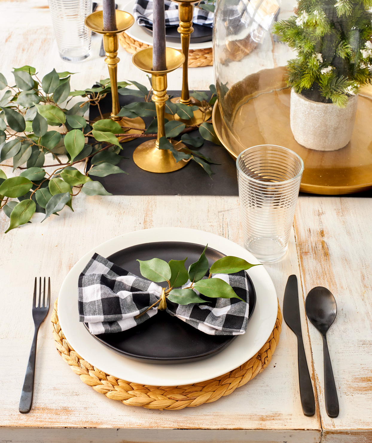 black and white centerpiece with plaid napkin