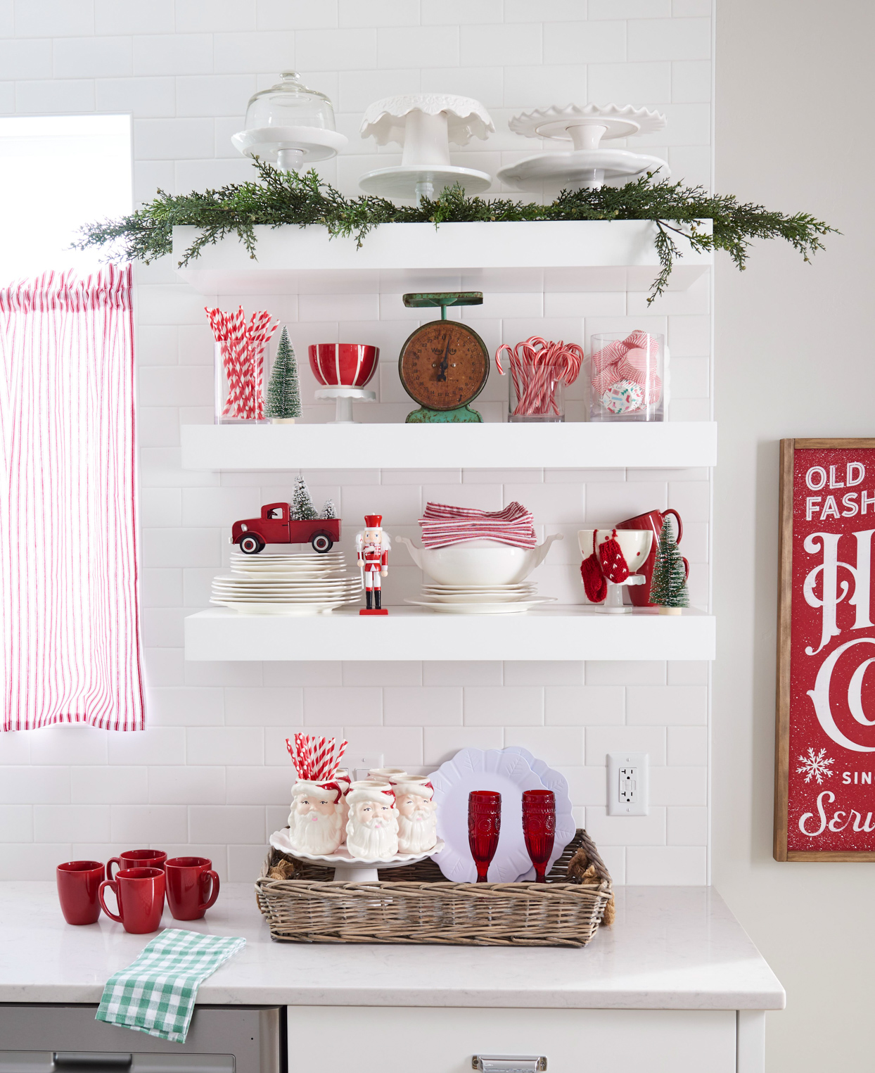 exposed white shelves with red christmas decorations