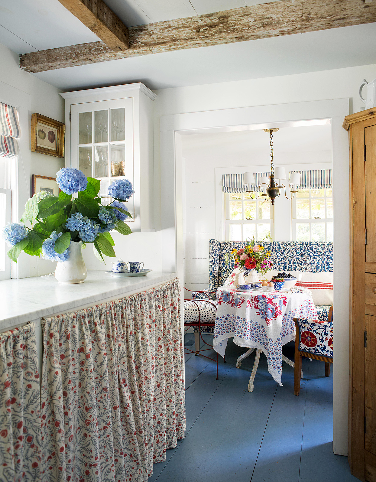 cottage farmhouse dining and breakfast nook with blue floors