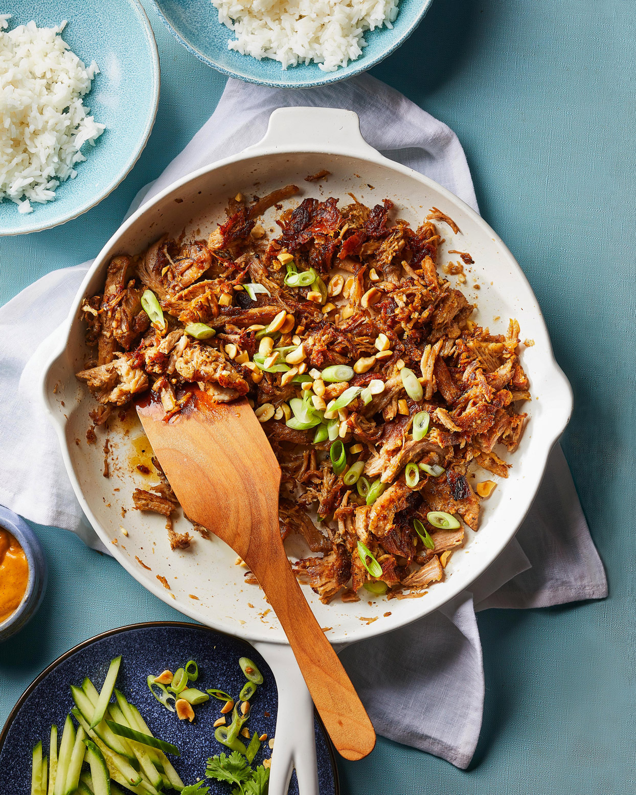 Shredded Pork Roast in a skillet with green onions