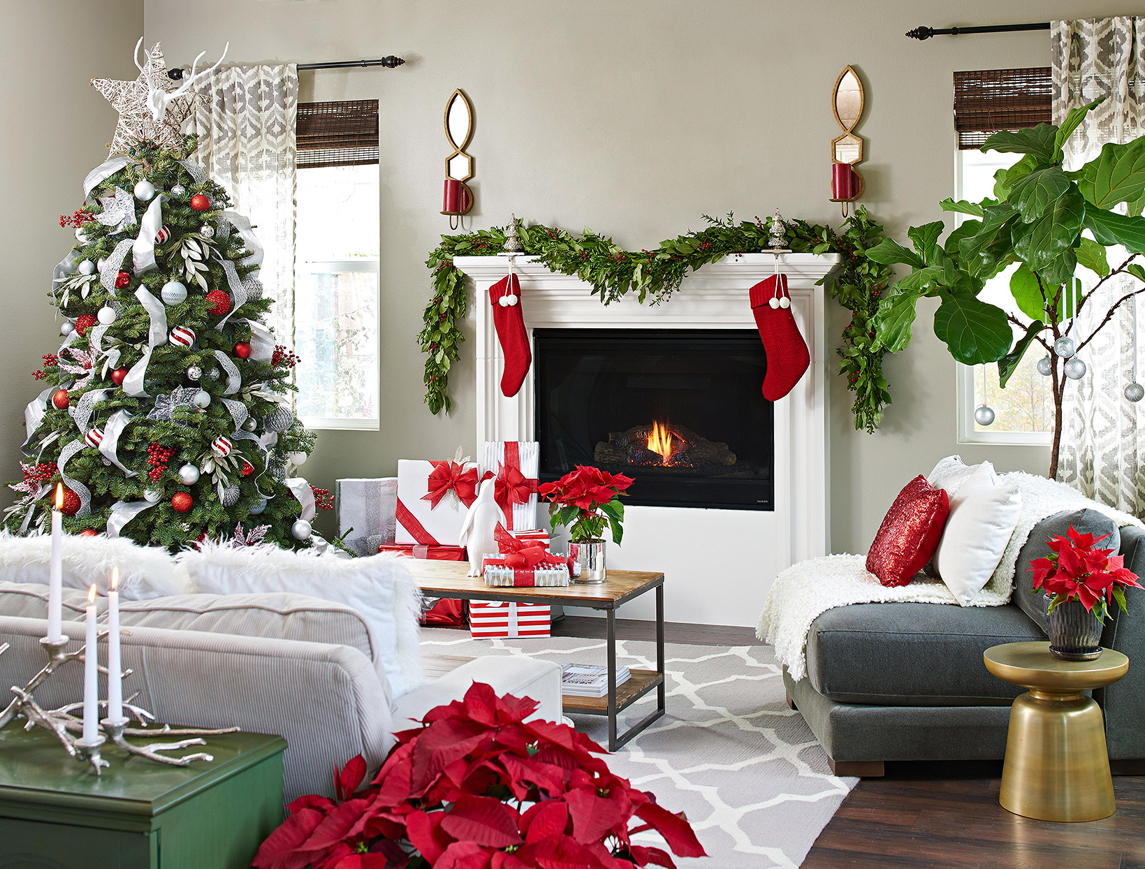red and silver Christmas décor, tree, and stockings in modern living room with taupe walls